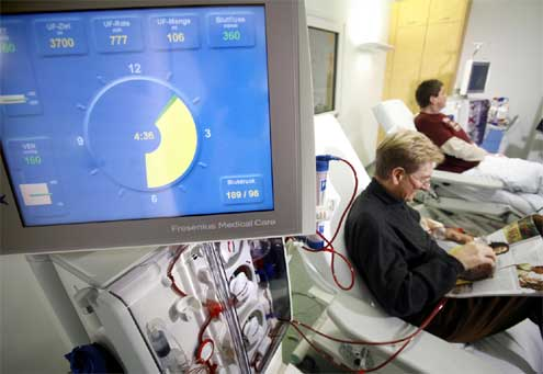 12 dialysis treatment stations with individual cable TVs with headsets and reclining, heated treatment chairs