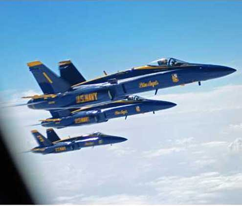us navy blue angel jets fly next to the refueling plane  image by jack