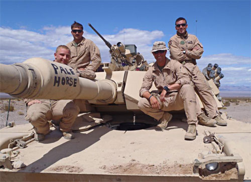1st Lt. Rob Paradis with his crew on a tank