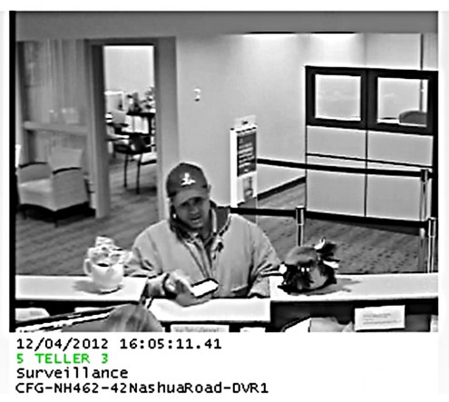 Suspect in Citizens Bank Robbery Photo passing note at counter at Londonderry Citizens Bank