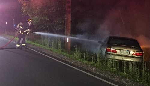 NH man dragged from burning auto after refusing to get out